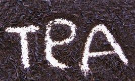 Zwart theebehang met grote diepte van gebied stock afbeelding