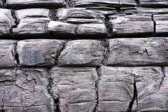 Zwart verkoold houten patroon De gebrande achtergrond van de boomtextuur Stock Foto