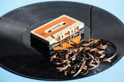 Zwart vinylverslag op gekleurde achtergrond Royalty-vrije Stock Afbeeldingen