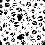 Zwart-wit dierlijk sporenpatroon stock illustratie