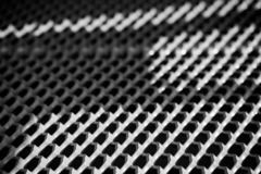 Zwart-wit geometrisch rooster met prikken stock foto's