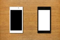 Zwart-witte smartphones op de lijst Stock Foto's