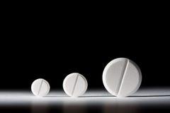 Zwart-witte tabletten, Stock Foto's
