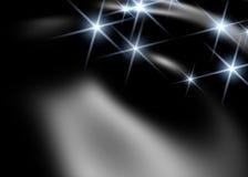 Zwarte achtergrond met witte lichten Stock Foto