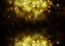 Zwarte achtergrond van de Bokeh de lichte gouden kleur Royalty-vrije Stock Afbeeldingen