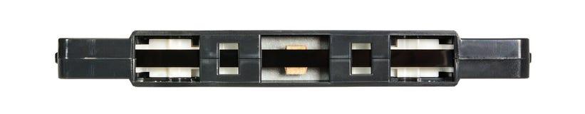 Zwarte audiocassette Sluit omhoog mening over de bodem, die op witte achtergrond wordt ge?soleerd stock afbeelding