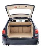 Zwarte auto met open bruine schone boomstam royalty-vrije stock afbeeldingen