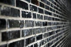 Zwarte bakstenen muur Stock Foto's