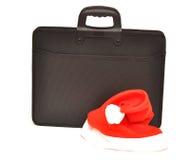 Zwarte bedrijfsaktentas met de hoed van de Kerstman Royalty-vrije Stock Afbeeldingen