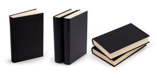 Zwarte boek lege dekking die met het knippen van weg wordt geplaatst Stock Afbeelding