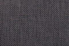 Zwarte bruine textielclose-up als achtergrond Structuur van de stoffenmacro Stock Foto's