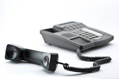 Zwarte bureautelefoon Stock Foto