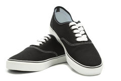 Zwarte canvastennisschoenen Stock Foto