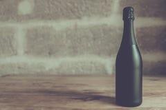 Zwarte champagnefles Royalty-vrije Stock Afbeelding
