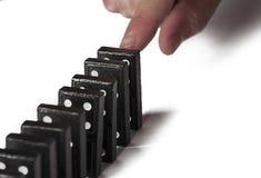 Zwarte die domino's op een witte achtergrond worden ge?soleerd De ruimte van het exemplaar stock fotografie