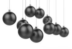 Zwarte die Kerstmisballen op witte achtergrond met selectiv worden geïsoleerd Royalty-vrije Stock Afbeeldingen