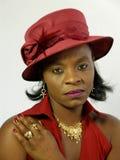 Zwarte die rode hoed draagt royalty-vrije stock afbeeldingen