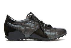 Zwarte die verwijfde schoen in werking stelt stock foto