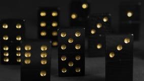 Zwarte domino's met gouden vlekken Stock Afbeelding