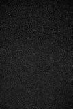 Zwarte of Donkere Grey Sand Paper-textuur met korrel royalty-vrije stock foto's