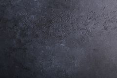 Zwarte donkere steen achtergrondtextuur achtergrondexemplaarruimte royalty-vrije stock fotografie