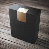 Zwarte doos met sticker Stock Foto's