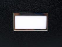 Zwarte doos met wit etiket stock foto's