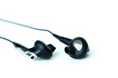 Zwarte earbud Royalty-vrije Stock Fotografie