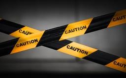 Zwarte en gele gestreepte voorzichtigheidsband Stock Foto