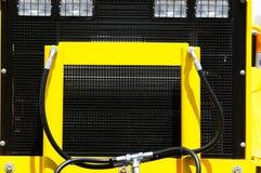 Zwarte en gele technologieachtergrond Stock Foto