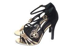 Zwarte en gouden damessandals Royalty-vrije Stock Afbeelding