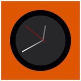 Zwarte en grijze ronde klok bij de oranje achtergrond Royalty-vrije Stock Fotografie