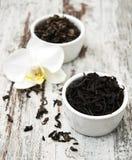 Zwarte en groene thee met orchideebloem Stock Foto