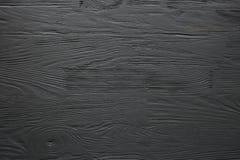Zwarte geschilderde houten textuur, achtergrond en behang stock foto