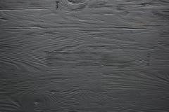Zwarte geschilderde houten textuur, achtergrond en behang Stock Afbeeldingen