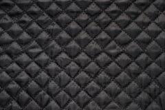 Zwarte gewatteerde stof Royalty-vrije Stock Afbeelding