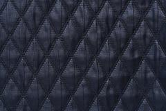 Zwarte gewatteerde stof als achtergrond Royalty-vrije Stock Foto
