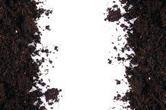 Zwarte grond dichte omhooggaand geïsoleerd op wit Stock Foto's