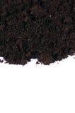 Zwarte grond dichte omhooggaand geïsoleerd op wit Royalty-vrije Stock Afbeelding