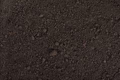 Zwarte grondtextuur Stock Afbeelding