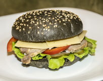 Zwarte hamburger Stock Afbeelding