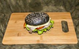 Zwarte hamburger Stock Fotografie