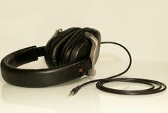 Zwarte hoofdtelefoons Stock Foto