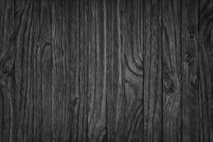 Zwarte houten achtergrond of sombere houten korreltextuur Stock Afbeelding