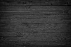 Zwarte houten achtergrond of sombere houten korreltextuur Royalty-vrije Stock Afbeeldingen