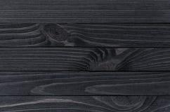 Zwarte houten textuur Stock Afbeeldingen