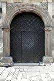 Zwarte ijzerdeuren Stock Foto
