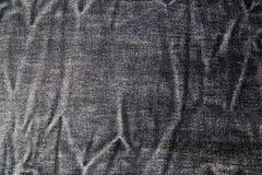 Zwarte jeanstextuur royalty-vrije stock foto