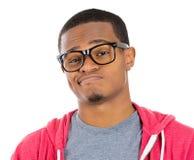 Zwarte kerel met sceptische blik op gezicht Stock Fotografie