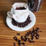 Zwarte koffie en koffiebonen royalty-vrije stock foto's